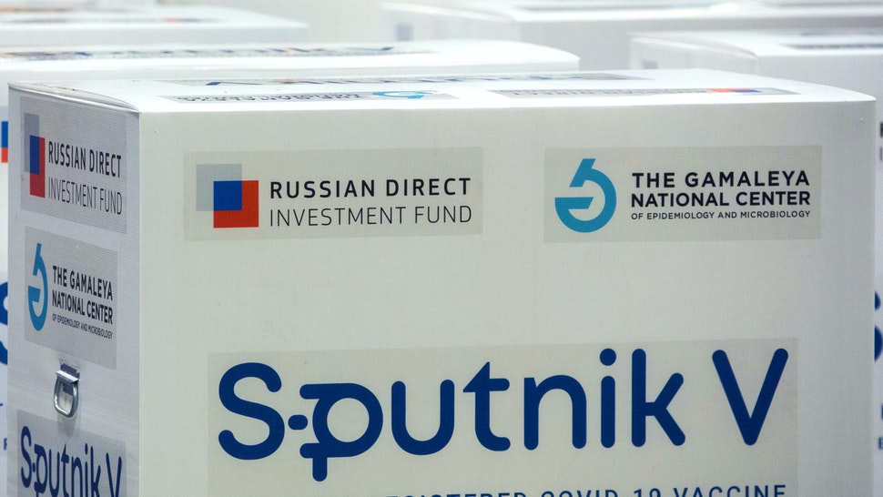 Branding reading 'The first registered Covid-19 vaccine' on boxes of the Sputnik V COVID-19 vaccine, developed by the Gamaleya National Research Center for Epidemiology and Microbiology and the Russian Direct Investment Fund (RDIF), at the cargo terminal at Sheremetyevo International Airport OAO in Moscow, Russia, on Thursday, Feb. 11, 2021. Montenegro and St. Vincent and the Grenadines approved Russian-developed vaccine for use, bringing total number of countries that have authorized it to 26, Russian Direct Investment Fund says in statement.