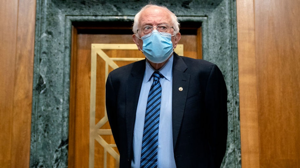 WASHINGTON, DC - FEBRUARY 25: Senator Bernie Sanders (I-V.T.), Chairman of the Budget Committee, arrives to a U.S. Senate Budget Committee hearing regarding wages at large corporations on Capitol Hill, February 25, 2021 in Washington, DC. The committee is looking at why many low-wage workers in America qualify for public benefits even though thousands of them are employees of large corporations.