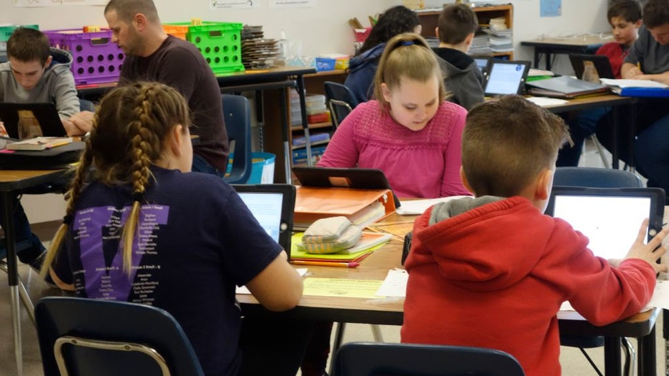 Students and Teacher Working in Social Studies Classroom, Wellsville, New York