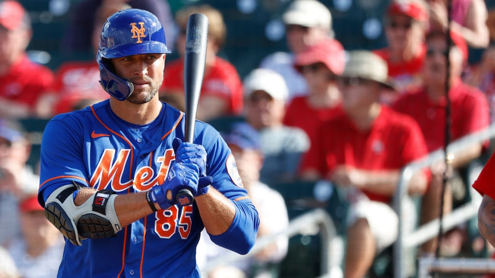 JUPITER, FL - MARCH 05: Tim Tebow #85 of the New York Mets looks on before stepping to the plate to bat against the St Louis Cardinals during a Grapefruit League spring training game at Roger Dean Stadium on March 5, 2020 in Jupiter, Florida. The game ended in a 7-7 tie. (Photo by Joe Robbins/Getty Images)