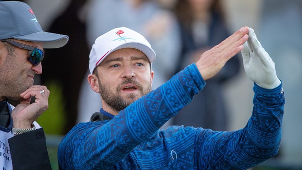 Justin Timberlake chats with his caddy before teeing off during day three of the Alfred Dunhill Links Championship at St Andrews.