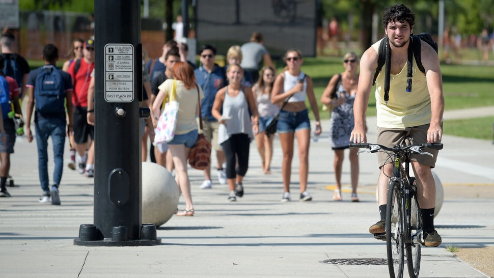 Students make their way across campus on the first day of classes for the fall semester at the University of Central Florida in Orlando, Fla., Monday, Aug. 24, 2015.
