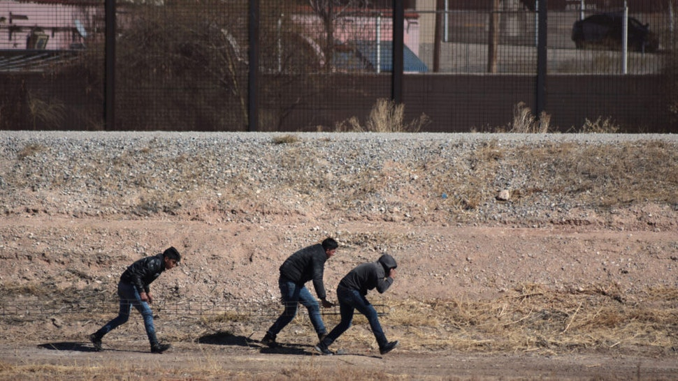 Three migrants tried to trick the border patrol to cross the border and reach the United States, but were detained by the agents in Juarez Chihuahua, Mexico, on 22 January 2021.