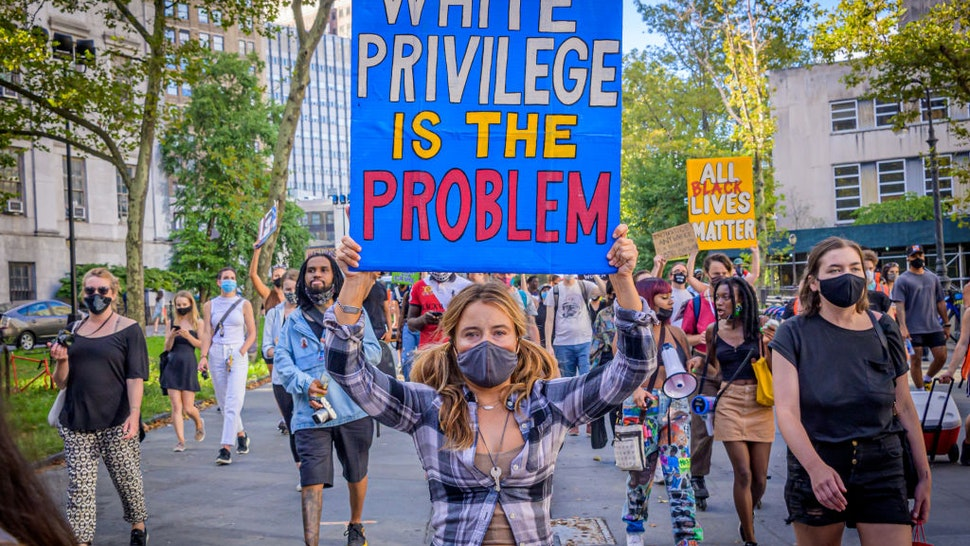 A participant holding a White Privilege Is The Problem sign at the protest. Brooklynites gathered at Cadman Plaza for a march in the streets of Brooklyn, bringing light to Black Women affected by police violence and to amplify the movement against police brutality and racial injustice. Riders For Black Lives participated by sending bikes to act as a buffer and shield protesters from cars and police.