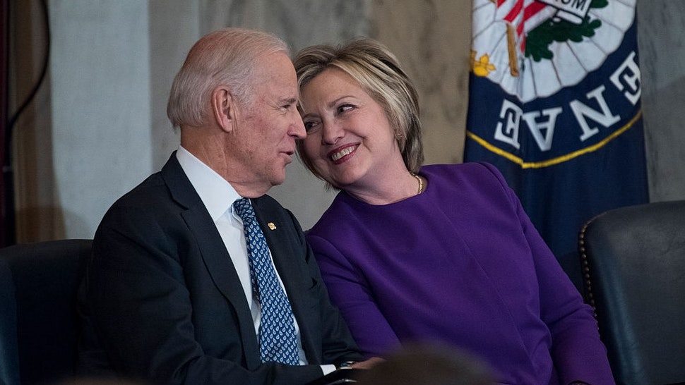 UNITED STATES - DECEMBER 08: Vice President Joe Biden and former Secretary of State Hillary Clinton attend a portrait unveiling ceremony for retiring Senate Minority Leader Harry Reid, D-Nev., in Russell Building's Kennedy Caucus Room, December 08, 2016. (Photo By