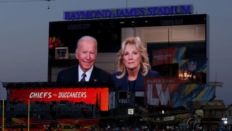 TAMPA, FLORIDA - FEBRUARY 07: U.S. president Joe Biden and First Lady Dr. Jill Biden deliver an address in Super Bowl LV at Raymond James Stadium on February 07, 2021 in Tampa, Florida. (Photo by