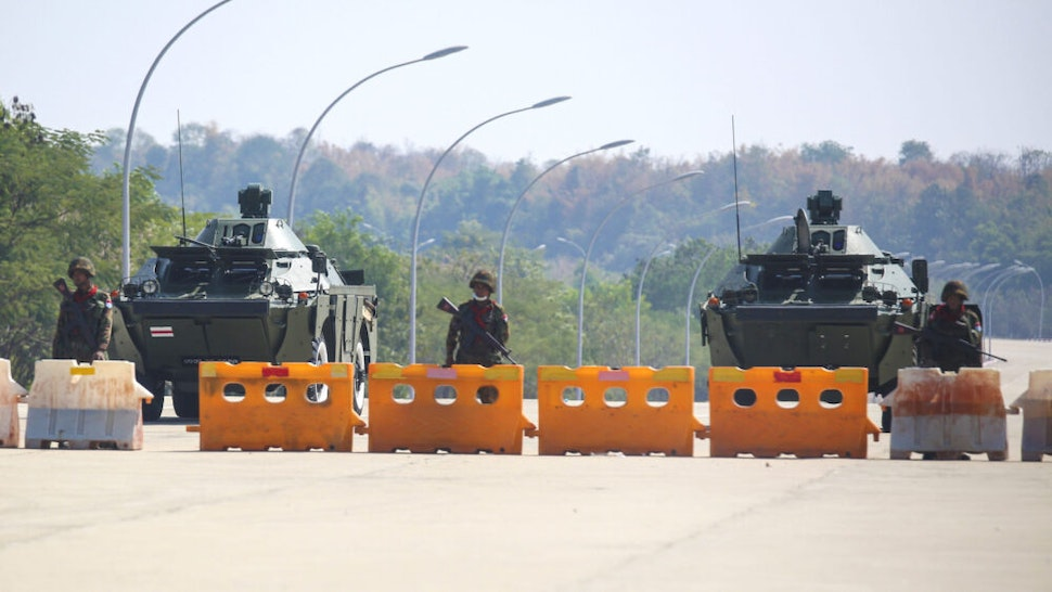 NAYPYIDAW, MYANMAR - FEBRUARY 01: Military soldiers with tanks and police truck block the road near parliament in Naypyidaw this afternoon in Myanmar on February 1, 2021. Myanmar's military announced Monday that it has seized power and will rule the country for at least one year after detaining its top political leaders.