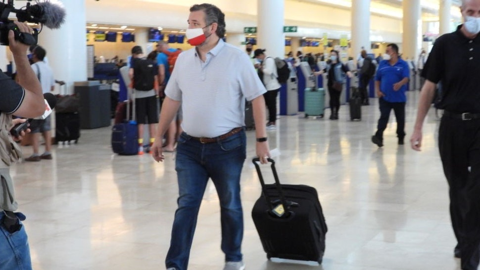 CANCUN, MEXICO - FEBRUARY 18: Sen. Ted Cruz (R-TX) checks in for a flight at Cancun International Airport after a backlash over his Mexican family vacation as his home state of Texas endured a Winter storm on February 18, 2021 in Cancun, Quintana Roo, Mexico. The Republican politician came under fire after leaving for the warm holiday destination as hundreds of thousands of people in the lone star state suffered a loss of power. Reports stated that Cruz was due to catch a flight back to Ho