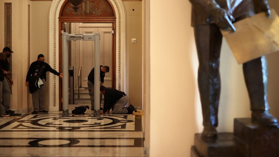 WASHINGTON, DC - JANUARY 12: U.S. Capitol Police install a metal detector at the doors of the House of Representatives Chamber January 12, 2021 in Washington, DC. At the direction of President Donald Trump, a mob attacked the U.S. Capitol on January 6 and security has been tightened ahead of next week's presidential inauguration. (Photo by