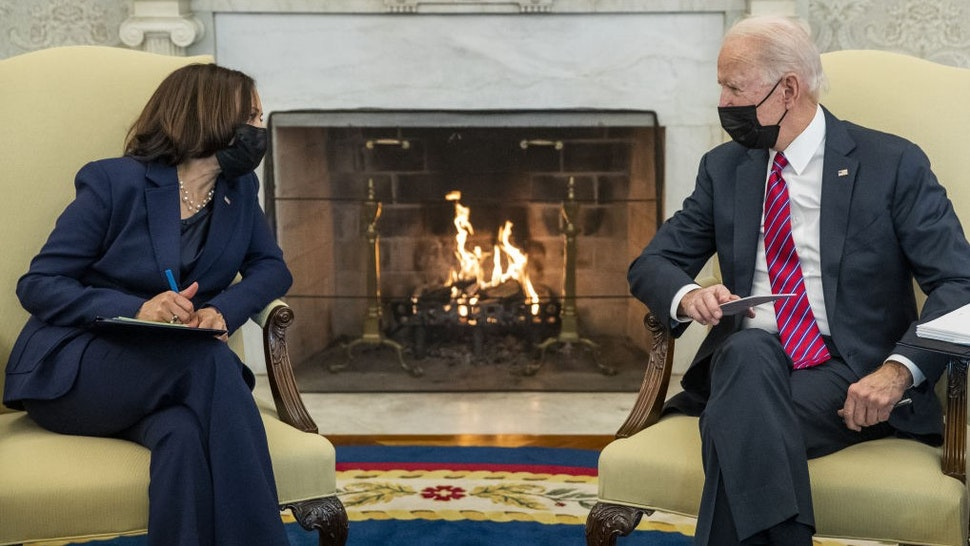"""U.S. President Joe Biden speaks with U.S. Vice President Kamala Harris during a meeting with Janet Yellen, U.S. Treasury secretary, not pictured, in the Oval Office of the White House in Washington, D.C., U.S., on Friday, Jan. 29, 2021. Yellensaid she'll try to """"better understand"""" the financial risks of taking steps to combat climate change, while expressing support for Biden's decision to cancel the Keystone XL Pipeline.Photographer:"""