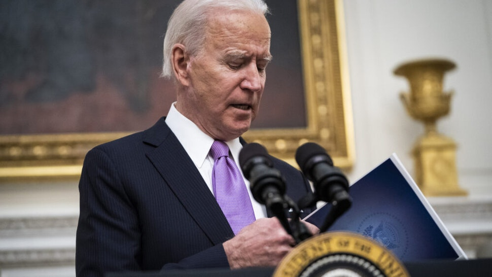 WASHINGTON, DC - JANUARY 21: President Joe R. Biden, with Vice President Kamala Harris by his side, speaks about the COVID-19 coronavirus pandemic before signing executive orders in the State Dining Room at the White House on Thursday, Jan 21, 2021 in Washington, DC.