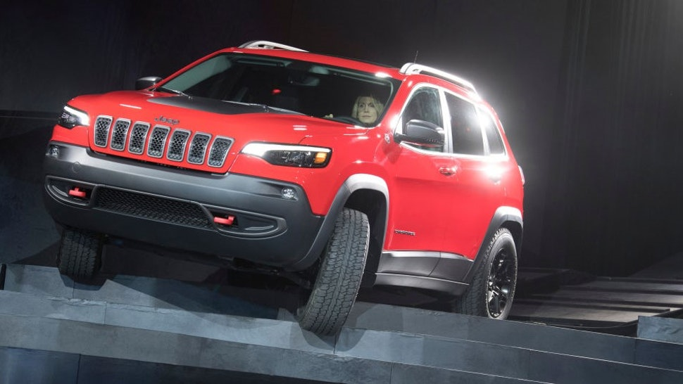 The new Jeep Cherokee drives down a stairs during a presentation at the 2018 North American International Auto Show (NAIAS) in Detroit, USA, 16 January 2018. Photo: Boris Roessler/dpa (Photo by