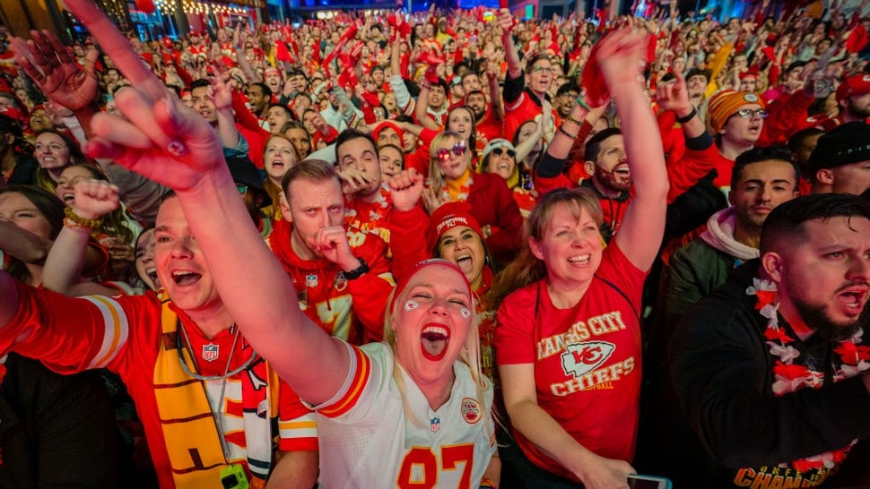 KANSAS CITY, MO - FEBRUARY 02: Fans cheer on the Chiefs at the Power and Light District as the Kansas City Chiefs play the San Francisco 49ers in the Super Bowl on February 2, 2020 in Kansas City, Kansas. (Photo by