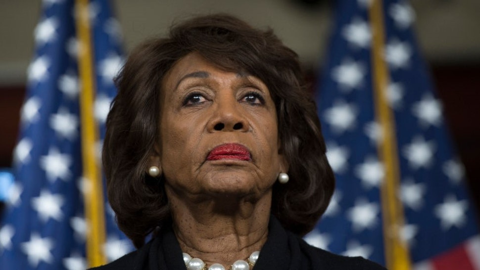 US Representative Maxine Waters (D-CA) looks on before speaking to reports regarding the Russia investigation on Capitol Hill in Washington, DC on January 9, 2018. (Photo by Andrew CABALLERO-REYNOLDS / AFP) (Photo by