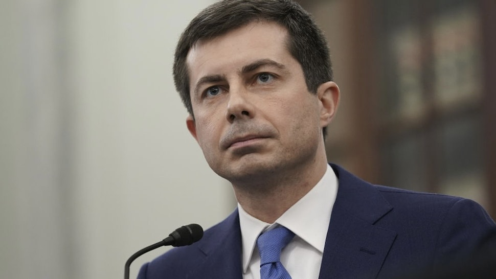 """Pete Buttigieg, U.S. secretary of transportation nominee for U.S. President Joe Biden, listens during a Senate Commerce, Science and Transportation Committee confirmation hearing in Washington, D.C., U.S., on Thursday, Jan. 21, 2021. Buttigieg, is pledging to carry out the administration's ambitious agenda to rebuild the n sation's infrastructure, calling it a """"generational opportunity"""" to create new jobs, fight economic inequality and stem climate change. Photographer: Stefani Reynolds/Bloomberg"""