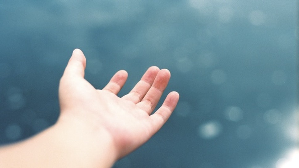 Cropped Image Of Hand Against Sea - stock photo