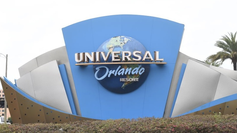Signage stands outside the entrance to the Universal Studios theme park in Orlando, Florida, U.S., on Friday, June 5, 2020. Universal Orlando began a phased reopening, becoming the first of the major theme parks in Central Florida to resume operations after the onset of the coronavirus pandemic. Photographer: Zack Wittman/Bloomberg