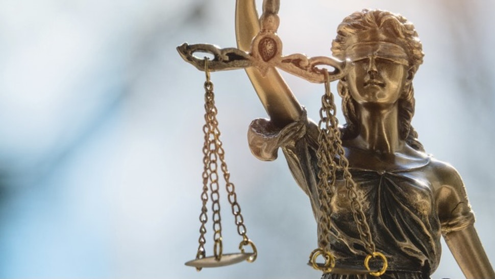 Close-Up Of Statue - stock photo Lady Justice or Justicia in front of blurred background. Goddess of justice.