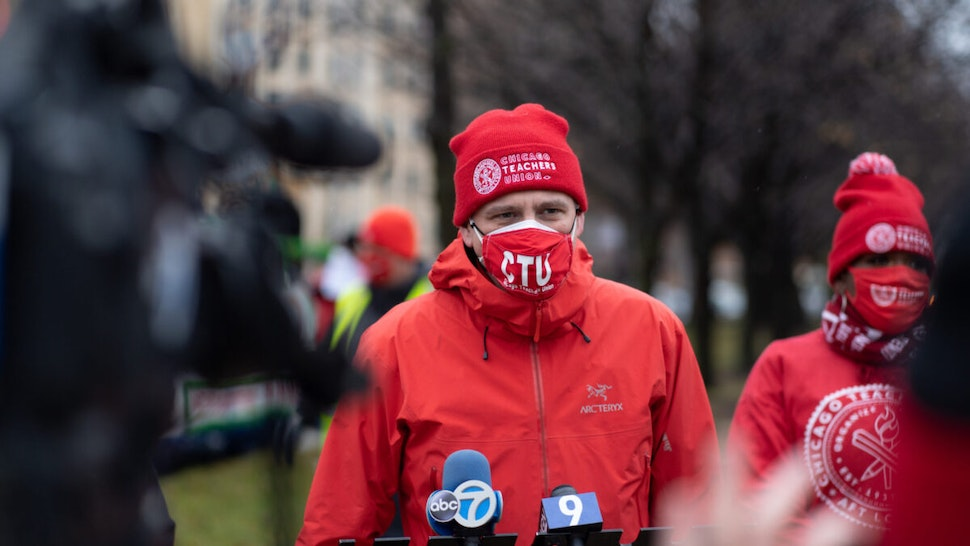 Chicago Teachers Union President Jesse Sharkey speaks ahead of a car caravan where teachers and supporters gathered to demand a safe and equitable return to in-person learning during the COVID-19 pandemic in Chicago, IL on December 12, 2020.
