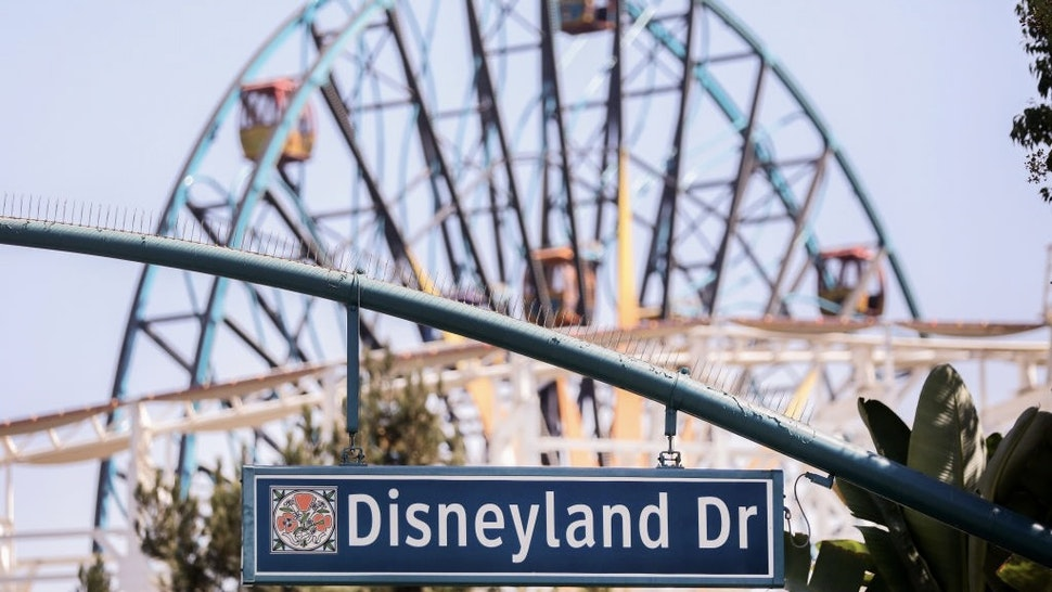 ANAHEIM, CALIFORNIA - SEPTEMBER 30: A sign for Disneyland Drive hangs near empty amusement rides on September 30, 2020 in Anaheim, California. Disney is laying off 28,000 workers amid the toll of the COVID-19 pandemic on theme parks. (Photo by Mario Tama/Getty Images)