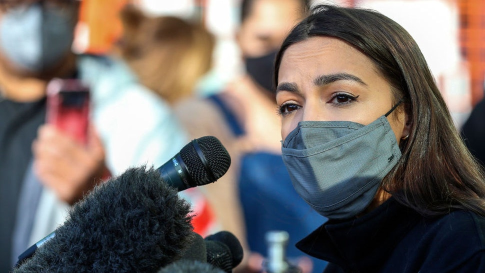 Congresswoman Alexandria Ocasio-Cortez speaks to the media at the Houston Food Bank on February 20, 2021 in Houston, Texas. - The lawmakers address the weather disaster in Texas and helped distribute food at the food bank. (Photo by Thomas Shea / AFP) (Photo by THOMAS SHEA/AFP via Getty Images)