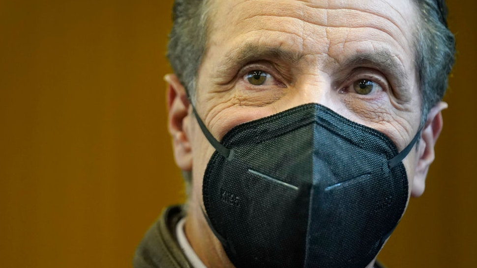 New York Governor Andrew Cuomo walks through a vaccination site after speaking in the Brooklyn borough of New York, on February 22, 2021.
