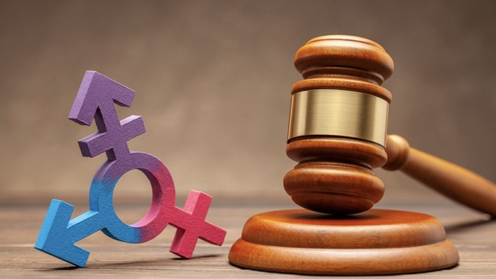 Transgender symbol and judge gavel on brown background. Concept of prohibition or permission for parade or marriage - stock photo Transgender symbol and judge gavel on brown background. Concept of prohibition or permission for parade or marriage.