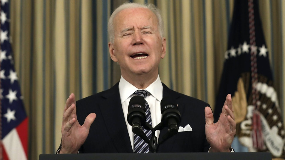 U.S. President Joe Biden speaks on the implementation of the American Rescue Plan in the State Dining Room of the White House in Washington, D.C., U.S., on Monday, March 15, 2021. Biden is planning the first major federal tax hike since 1993 to help pay for the long-term economic program designed as a follow-up to his pandemic-relief bill, according to people familiar with the matter.