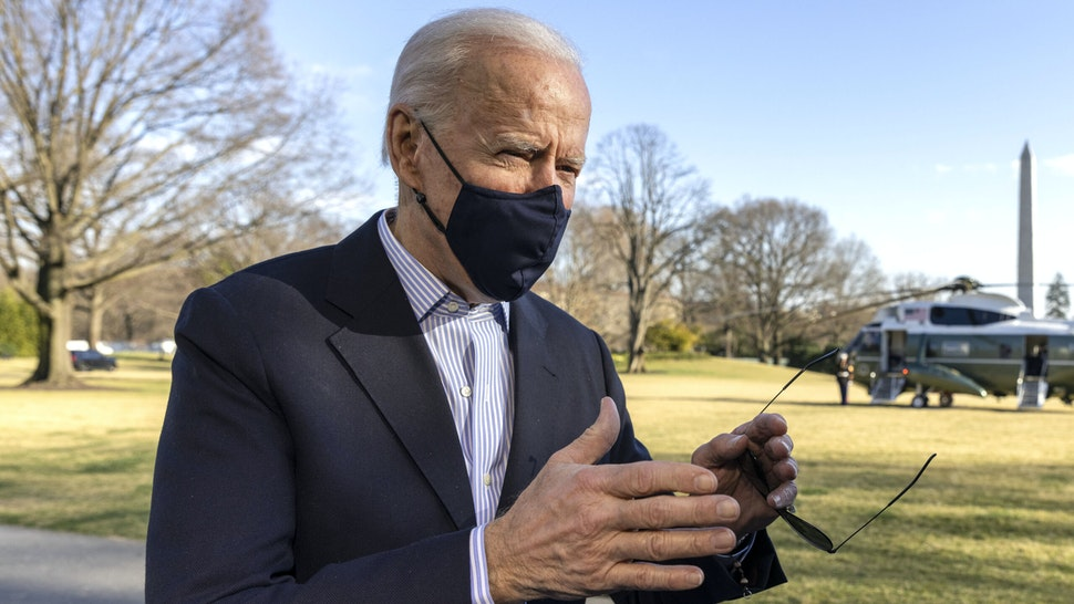 WASHINGTON, DC - MARCH 21: U.S. President Joe Biden stops to talk to reporters on the South Lawn of the White House on March 21, 2021 in Washington, DC. The President and first lady spent the weekend at Camp David with family.