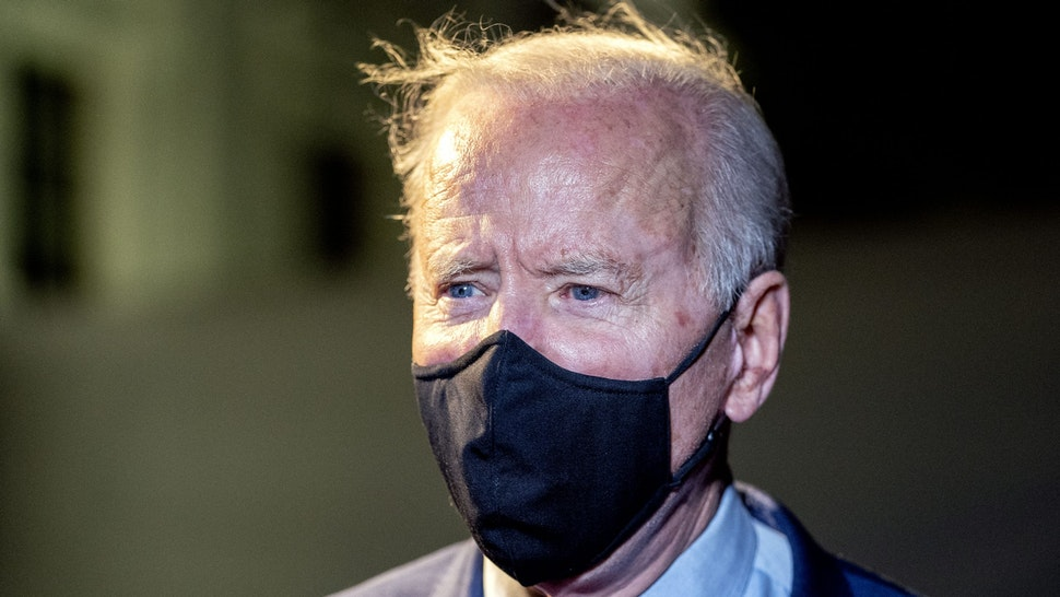 U.S. President Joe Biden wears a protective mask while speaking to members of the media on the South Lawn of the White House after arriving on Marine One in Washington, D.C., U.S., on Tuesday, March 23, 2021. Biden traveled to Ohio to promote his $1.9 trillion stimulus, as Democrats take aim at a Senate seat that will be open in next year's midterm elections.