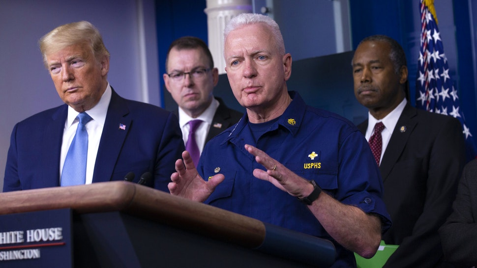 """Brett Giroir, U.S. assistant secretary for health, center, speaks during a Coronavirus Task Force news conference in the briefing room of the White House in Washington, D.C., U.S., on Saturday, March 21, 2020. President Donald Trump said negotiators in Congress and his administration are """"very close"""" to agreement on a coronavirus economic-relief plan that his economic adviser said will aim to boost the U.S. economy by about $2 trillion."""