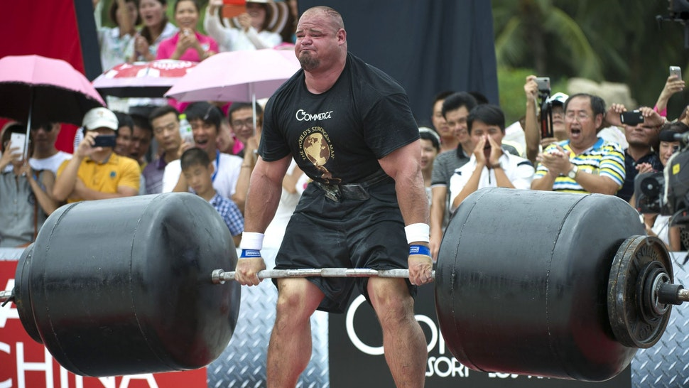 HAINAN ISLAND, CHINA - AUGUST 24: Brian Shaw of USA competes at the Deadlift for Max event during the World's Strongest Man competition at Yalong Bay Cultural Square on August 24, 2013 in Hainan Island, China.