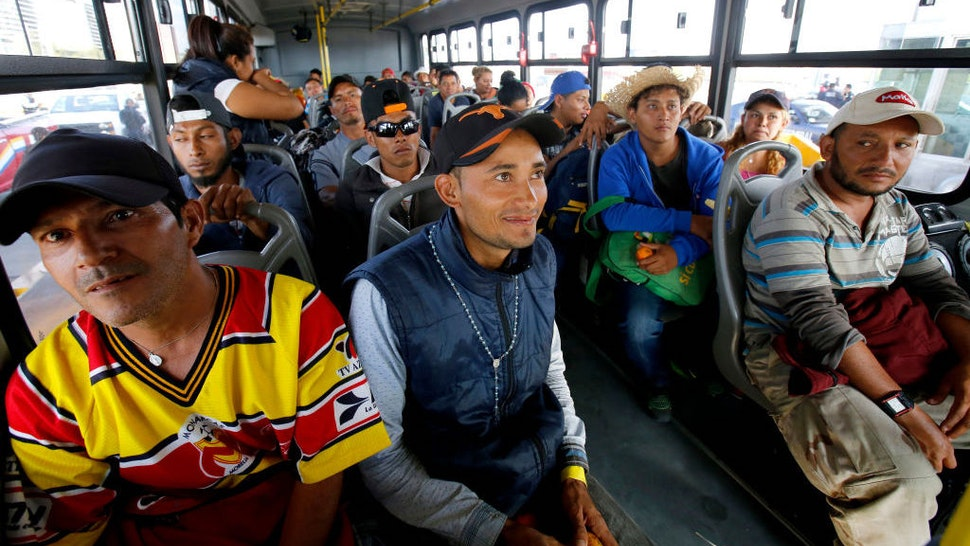 Central American migrants — mostly Hondurans — moving in a caravan towards the United States, board buses to head to a shelter in the outskirts of Zapotlanejo, Jalisco state, Mexico, on November 11, 2018. - The United States embarked Friday on a policy of automatically rejecting asylum claims of people who cross the Mexican border illegally in a bid to deter Central American migrants and force Mexico to handle them. (Photo by Ulises Ruiz/AFP via Getty Images)