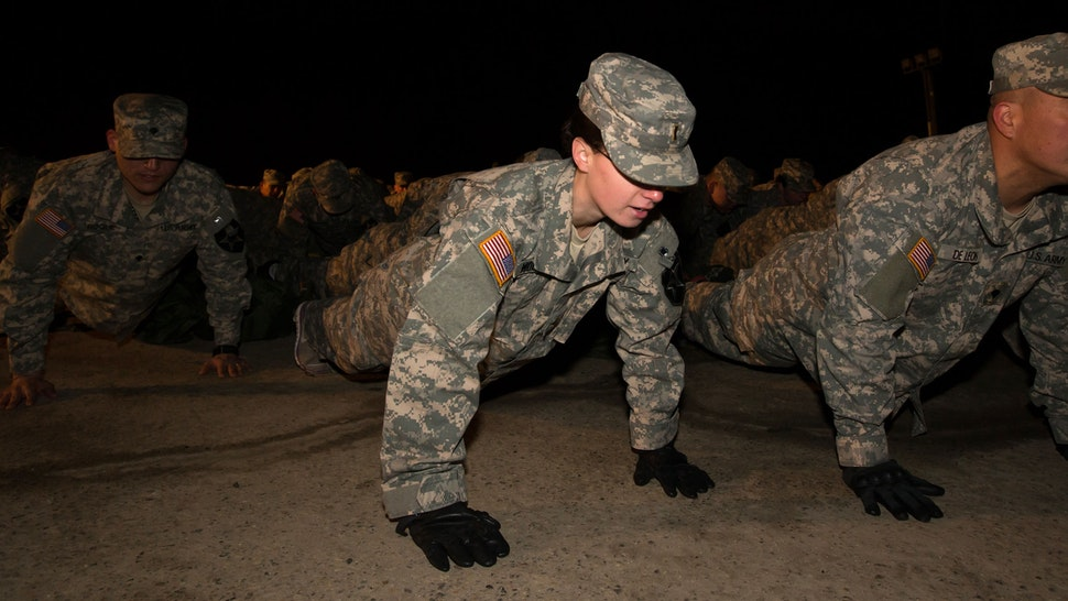 Soldiers with the U.S. Army's Second Infantry Division do push-ups during an air assault training course before dawn at Camp Casey in Dongducheon, South Korea, on Tuesday, Feb. 26, 2013. The U.S. has 28,500 soldiers in South Korea as a legacy of the 1950-53 Korean War, which ended in a cease-fire that left the two Koreas technically still at war.