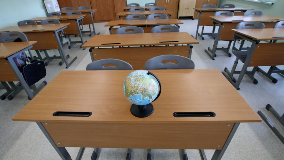 MOSCOW, RUSSIA - MAY 23, 2020: A globe in an empty classroom at No 2127 Comprehensive School during the pandemic of the novel coronavirus disease (COVID-19). Sergei Karpukhin/TASS
