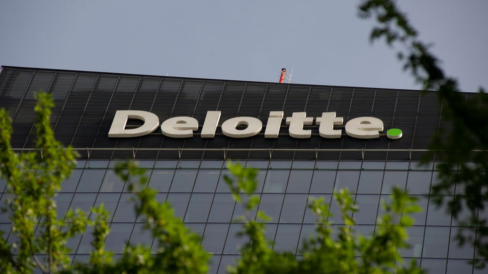 Multinational professional services network company Deloitte sign is seen on top of the Q22 offices complex on September 19, 2020 in Warsaw, Poland.