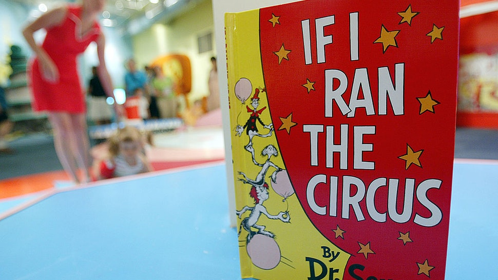 NEW YORK - JULY 6: A Dr. Seuss book is seen as children play during a press preview of an interactive exhibition dedicated to Dr. Seuss at the Children's Museum of Manhattan July 6, 2004 in New York City. The 4,000 square-foot exhibit is titled, 'Oh Suess! Off to Great Places' and will remain open at the museum until July 2005.