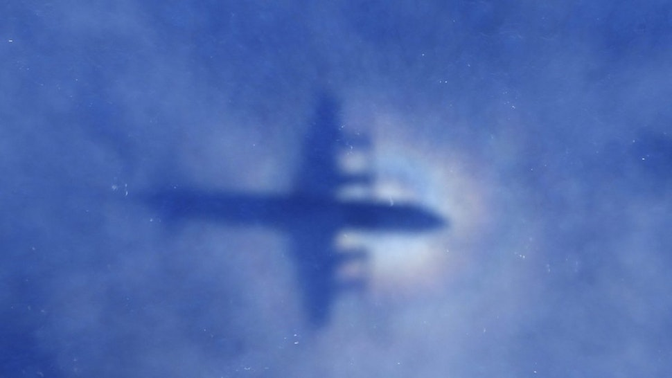 This shadow of a Royal New Zealand Air Force P3 Orion aircraft is seen on low cloud cover while it searches for missing Malaysia Airlines flight MH370, over the Indian Ocean on March 31, 2014.