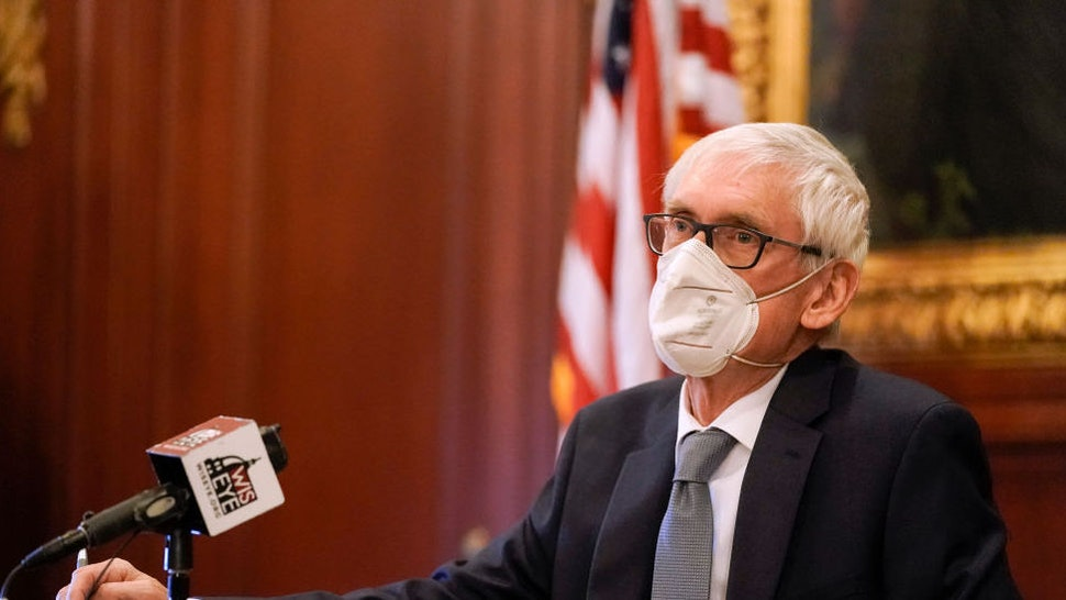 Wisconsin Gov. Tony Evers, a member of Wisconsin's Electoral College, cast his vote at the state Capitol in Madison, Wis., Monday, Dec. 14, 2020.