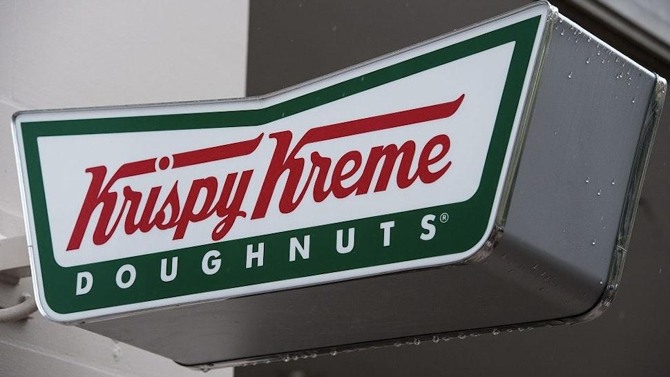 A Krispy Kreme doughnut shop sign is seen in Washington, DC, on May 9, 2016.
