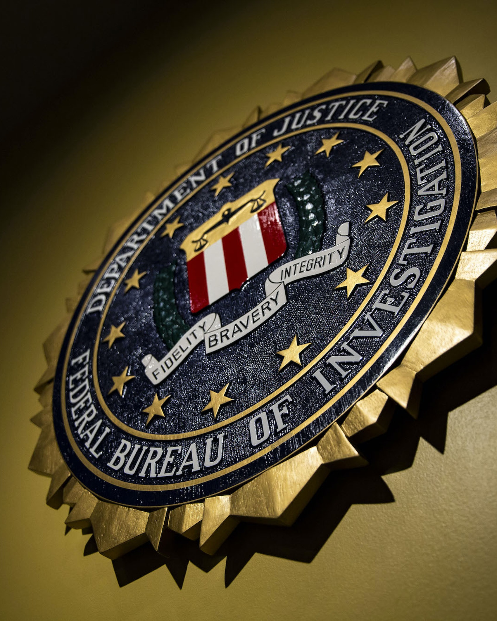 The seal of the Federal Bureau of Investigation (FBI) hangs on a wall before a news conference at the FBI headquarters in Washington, D.C.