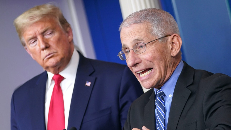 US President Donald Trump (L) listens as Director of the National Institute of Allergy and Infectious Diseases Anthony Fauci speaks during the daily briefing on the novel coronavirus, COVID-19, at the White House on March 24, 2020, in Washington, DC.