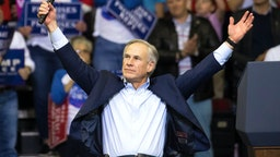 HOUSTON, TX - OCTOBER 22: Governor Greg Abbott of Texas addresses the crowd before President Donald Trump took the stage for a rally in support of Sen. Ted Cruz (R-TX) on October 22, 2018 at the Toyota Center in Houston, Texas. Cruz, the incumbent, is seeking Senate re-election in a high-profile race against Democratic challenger Beto O'Rourke.