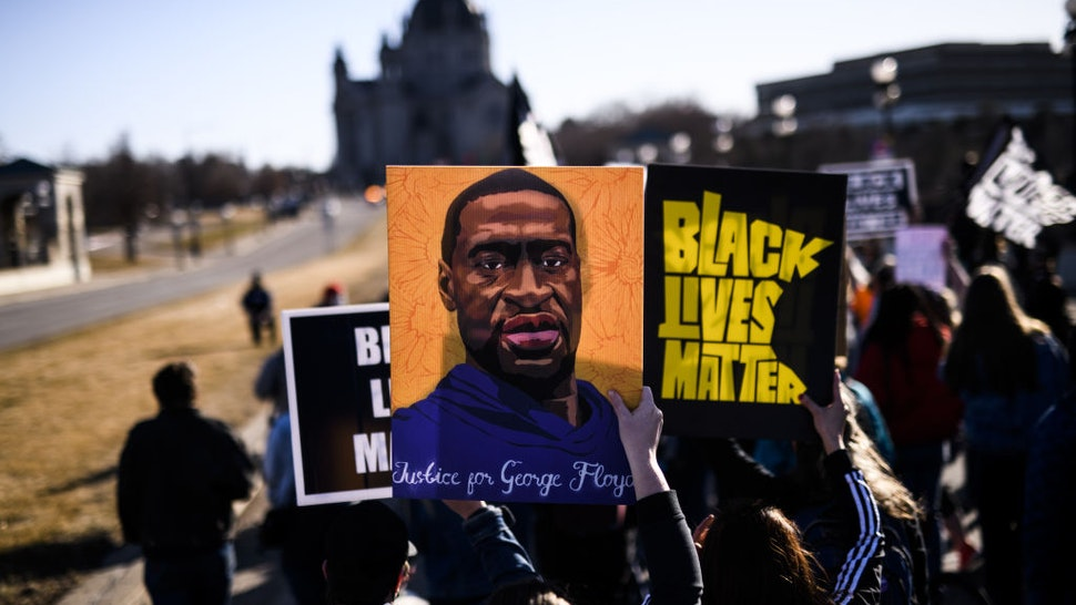 ST PAUL, MN - MARCH 19: People march near the Minnesota State Capitol to honor George Floyd on March 19, 2021 in St Paul, Minnesota. This morning Judge Peter Cahill rejected motions for change of venue and continuance by the defense of former Minneapolis Police officer Derek Chauvin, who is accused of killing George Floyd last May.