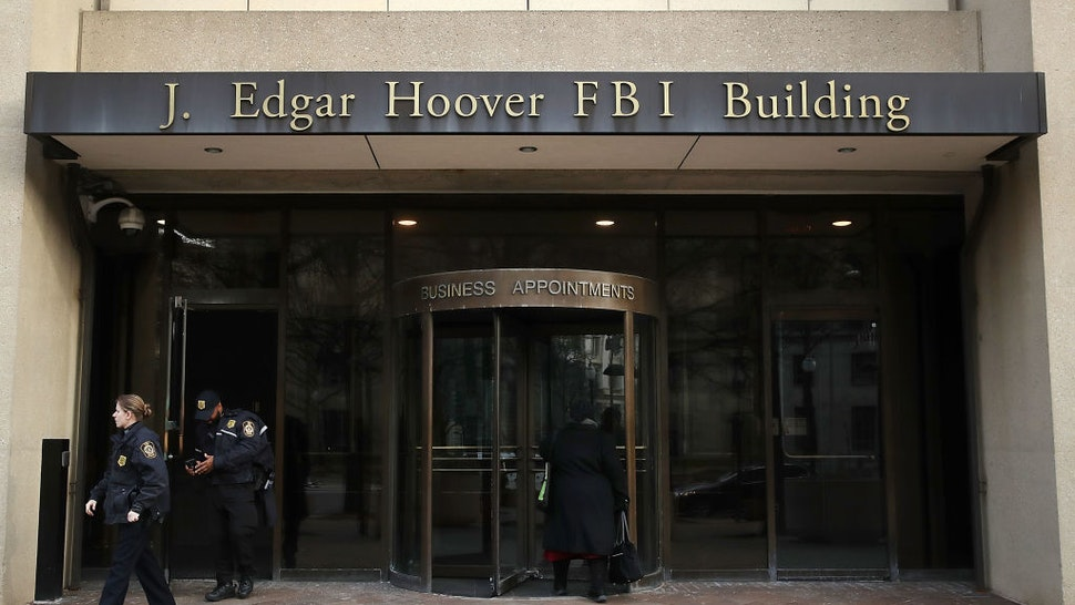 law enforcement officers walk out of the J. Edgar Hoover FBI Building on January 28, 2019 in Washington, DC.