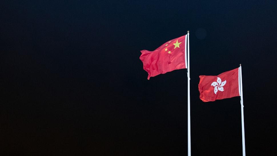China and Hong Kong flags - stock photo China and Hong Kong flag outside the legislation council. Protest against extradition to China bill. 2019 Jun 16th. Hong Kong