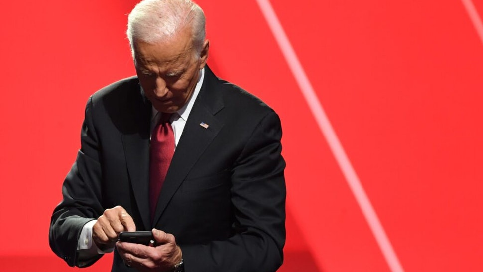 Democratic presidential hopeful former US Vice President Joe Biden looks at his phone after the fourth Democratic primary debate of the 2020 presidential campaign season co-hosted by The New York Times and CNN at Otterbein University in Westerville, Ohio on October 15, 2019.
