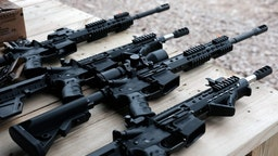 "GREELEY, PENNSYLVANIA - OCTOBER 12: AR-15 rifles and other weapons are displayed on a table at a shooting range during the ""Rod of Iron Freedom Festival"" on October 12, 2019 in Greeley, Pennsylvania. The two-day event, which is organized by Kahr Arms/Tommy Gun Warehouse and Rod of Iron Ministries, has billed itself as a ""second amendment rally and celebration of freedom, faith and family."" Numerous speakers, vendors and displays celebrated guns and gun culture in America."