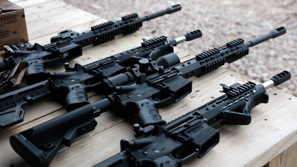 """GREELEY, PENNSYLVANIA - OCTOBER 12: AR-15 rifles and other weapons are displayed on a table at a shooting range during the """"Rod of Iron Freedom Festival"""" on October 12, 2019 in Greeley, Pennsylvania. The two-day event, which is organized by Kahr Arms/Tommy Gun Warehouse and Rod of Iron Ministries, has billed itself as a """"second amendment rally and celebration of freedom, faith and family."""" Numerous speakers, vendors and displays celebrated guns and gun culture in America."""