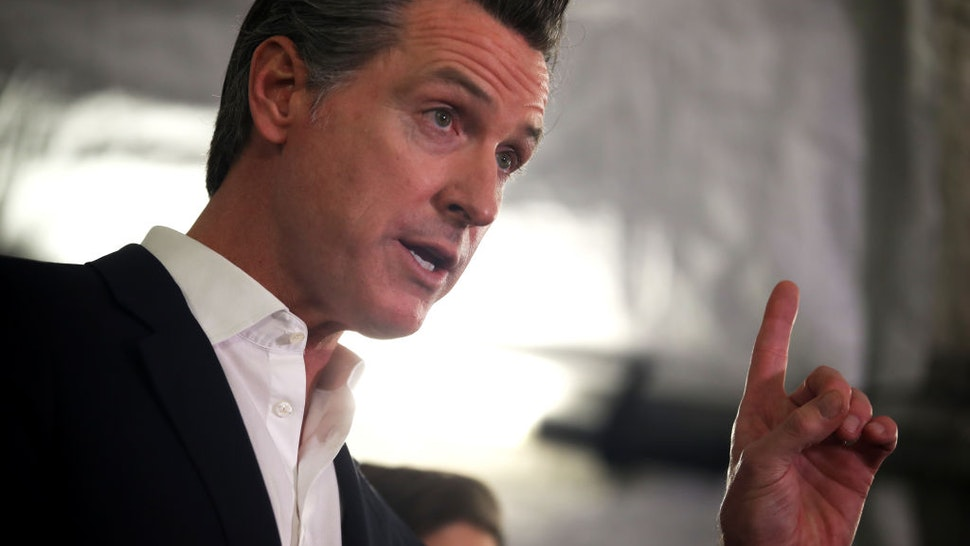 OAKLAND, CALIFORNIA - JANUARY 16: California Gov. Gavin Newsom speaks during a a news conference about the state's efforts on the homelessness crisis on January 16, 2020 in Oakland, California. Newsom was joined by Oakland Mayor Libby Schaaf to announce that Oakland will receive 15 unused FEMA trailers for the city to use as temporary housing and as mobile health and social services clinics for the homeless. Newsom signed on executive order on January 8 to deploy 100 trailers and crisis response teams to areas in need across the state.
